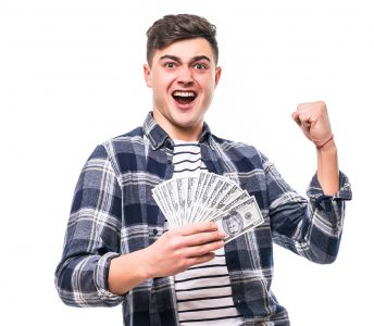 man in casual clothing holding fan of money